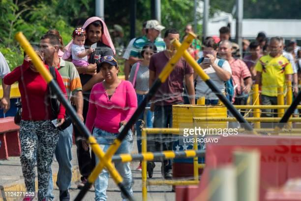 People cross the Francisco de Paula Santander International Bridge from Cucuta in Colombia to Urena in Venezuela on February 12 2019 The tug of war...
