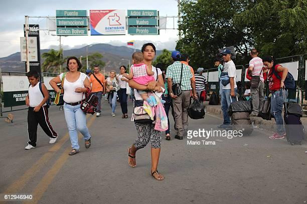 People cross the international border bridge between Colombia and Venezuela on October 4 2016 in Cucuta Colombia The dire economic crisis in...
