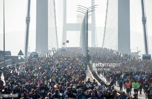 TOPSHOT People cross the July 15 Martyrs' Bridge known as the Bosphorus Bridge during the 40th Istanbul Marathon on November 11 in Istanbul