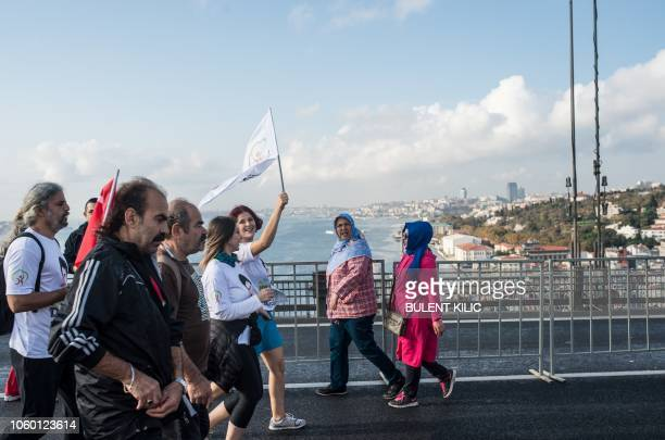 People cross the July 15 Martyrs' Bridge known as the Bosphorus Bridge during the 40th Istanbul Marathon on November 11 in Istanbul