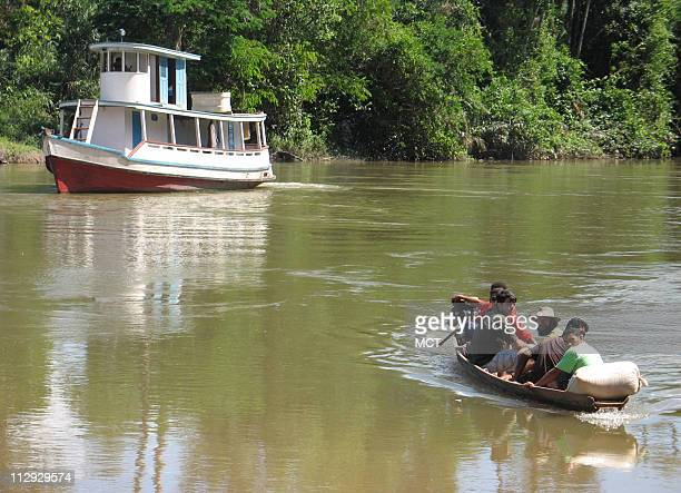 People cross the Moju River June 21 near Tailandia Brazil On the other side is a privately owned property where clandestine foresters have cut down...