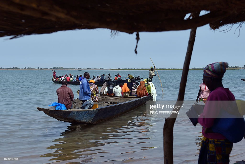 People cross the Niger river on January 22, 2013 in Segou, 240 kms north of Bamako, as life starts returning to normal following the French-led offensive in Mali. Mali's army chief said on January 22 that his French-backed forces could reclaim the northern towns of Gao and fabled Timbuktu from Islamists in a month, as more offers of aid poured in for the offensive. French planes bombed a major base of the Al-Qaeda in Islamic Maghreb (AQIM) near Timbuktu as local sources said a mansion belonging to Libyan former strongman Moamer Kadhafi was destroyed.