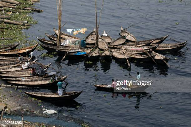 DHAKA BANGLADESH MARCH 21People cross the polluted Buriganga river by boat in Dhaka Bangladesh on March 21 2020 The chemical waste of mills and...