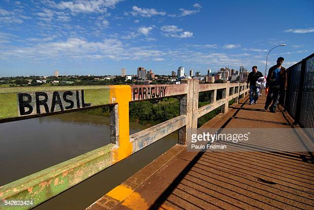People cross the Ponte da Amizade or the Friendship Bridge which links the border between Brazil and Paraguay