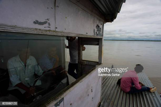 MAJULI JORHAT ASSAM INDIA People cross the river Brahmaputra by ferry to reach Majuli from Jorhat Majuli is the largest river island in the world...