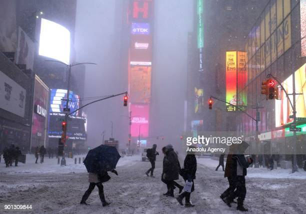 People cross the road during a snowstorm in northern part of New York United States on January 04 2018