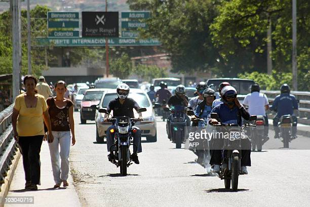 People cross the Simon Bolivar bridge that connects Colombia with Venezuela in Cucuta Colombia on July 22 2010 Venezuelan President Hugo Chavez...