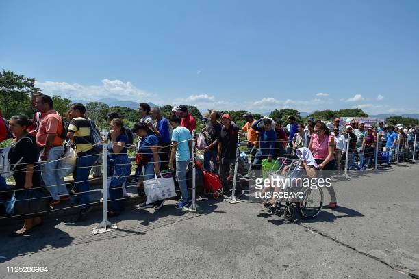 People cross the Simon Bolivar International bridge from Cucuta Colombia to San Antonio Tachira Venezuela on February 16 2019 Venezuelan opposition...