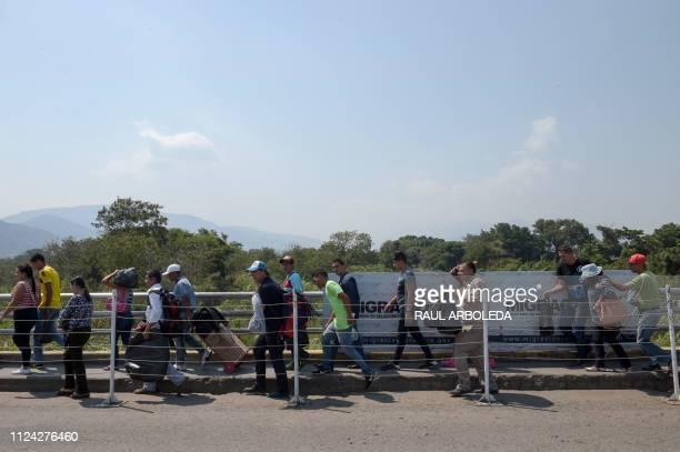 TOPSHOT People cross the Simon Bolivar International Bridge from Tachira in Venezuela to Villa del Rosario close to Cucuta in Colombia on February 12...