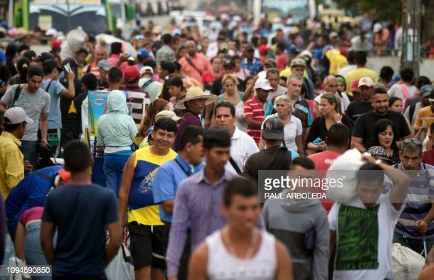 People cross the Simon Bolivar International Bridge on the border between Tachira in Venezuela and Cucuta in Colombia on February 6 2019