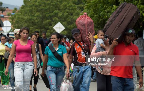 People cross the Simon Bolivar International Bridge on the border between Tachira in Venezuela and Cucuta in Colombia on February 7 2019 Venezuelan...