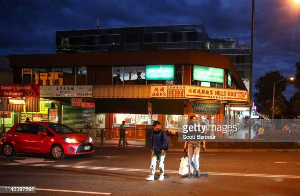 People cross the street at Box Hill Central in the electoral division of Chisholm on April 17 2019 in Melbourne Australia The electoral division of...