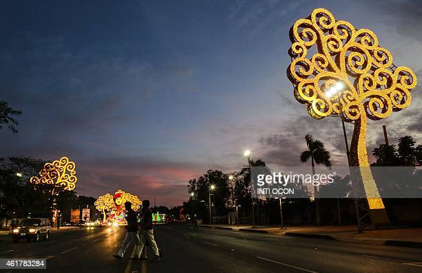 People cross the street in front of Hugo Chavez's roundabout in Managua on January 17 2015 AFP PHOTO/ Inti OCON