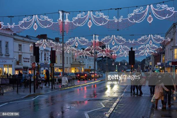 Stratford Upon Avon, UK - December 12, 2016: People cross the street on a shopping evening before Christmas in Stratford Upon Avon, UK