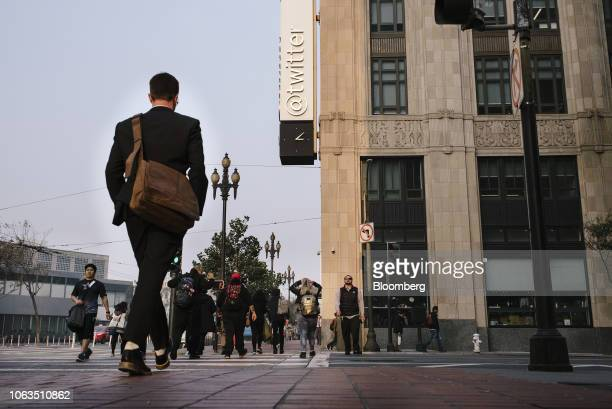People cross the street outside Twitter Inc. Headquarters in San Francisco, California, U.S., on Thursday, Nov. 15, 2018. Most tech stocks have been...