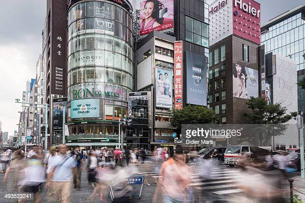 CONTENT] People cross the street with motion blur in the heart of Ginza the place for luxury shopping in Tokyo Japan