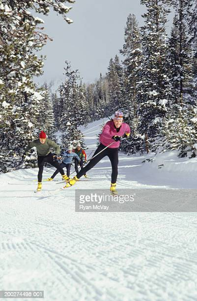 people cross-country skiing in mountains - nordic skiing event stock pictures, royalty-free photos & images