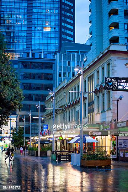 People crossing a street in downtown Auckland, New Zealand