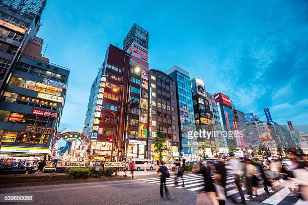 People crossing at Shinjuku district at dusk, Tokyo, Japan