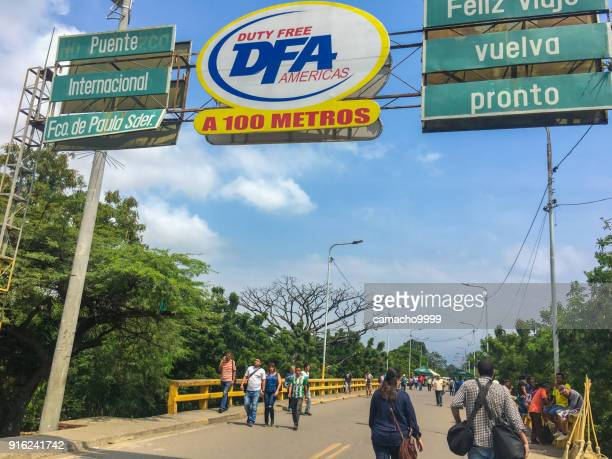 people crossing border from venezuela to colombia - cucuta stock pictures, royalty-free photos & images