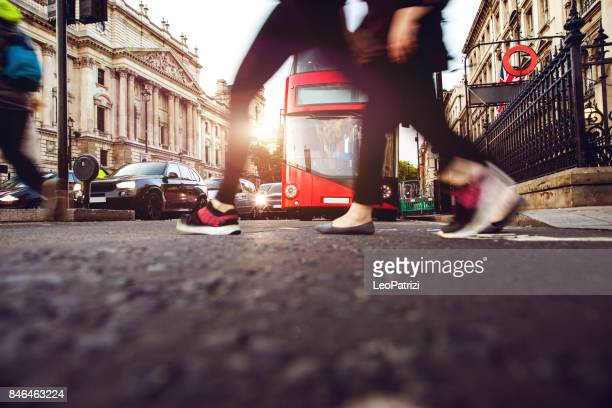 people crossing in central london - zebra crossing stock pictures, royalty-free photos & images