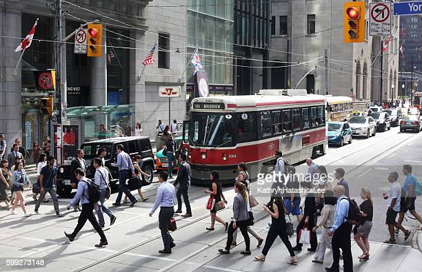 People Crossing King Street at Yonge, Downtown Toronto, Ontario, Canada