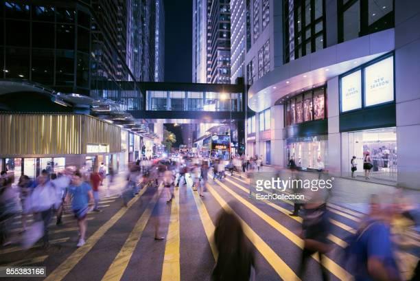 People crossing Queen's Road, Hong Kong at dusk