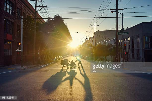 People crossing road at sunset, San Francisco, California, USA