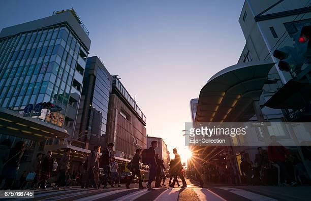People crossing Shijo-dori street in Kyoto, Japan