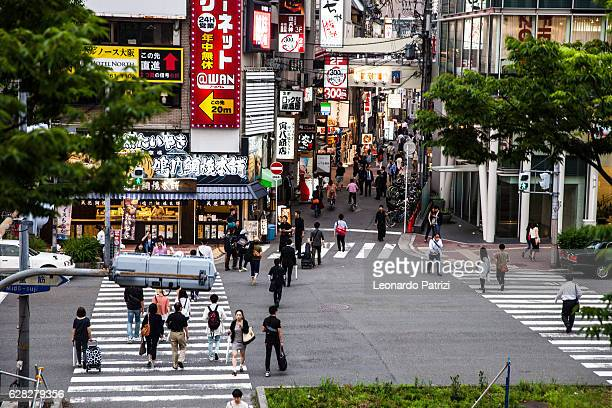 People crossing street in busy Osaka downtown