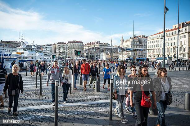 People crossing street in Marseille, France