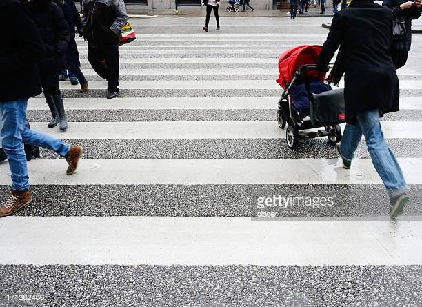 People crossing street in the rain