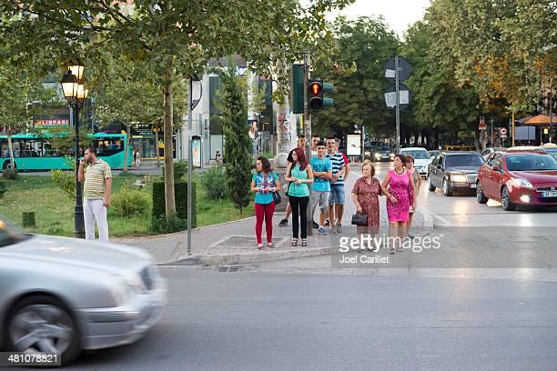 People crossing street in Tirana, Albania