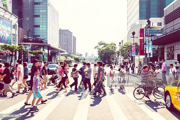 People Crossing Street On Sunny Day