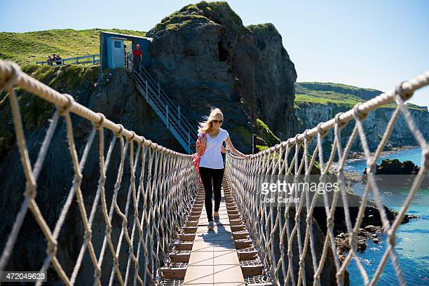 People crossing the Carrick-a-Rede Rope Bridge in County Antrim