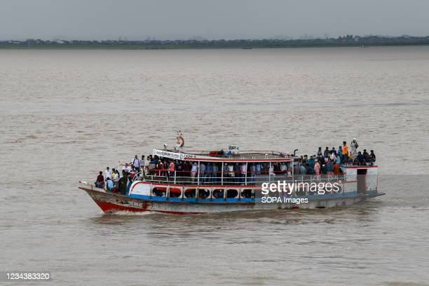 People crossing the Padma River by launch, return to their work areas after government relaxed the lockdown restrictions. Thousands of Bangladeshi...