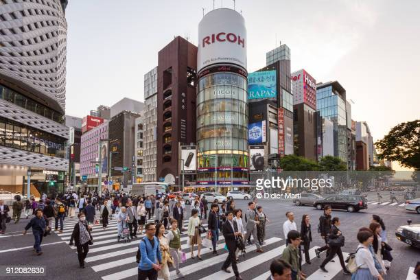 People crossing the street at the famous sanchome intersection in the Ginza in Tokyo