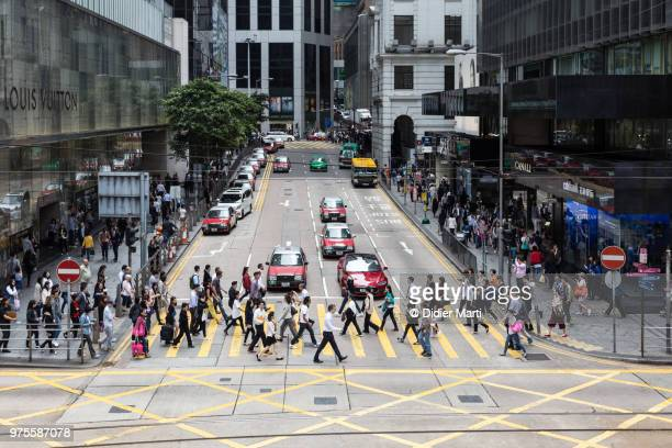 people crossing the street in hong kong central district in hong kong island, china sar - central stock pictures, royalty-free photos & images