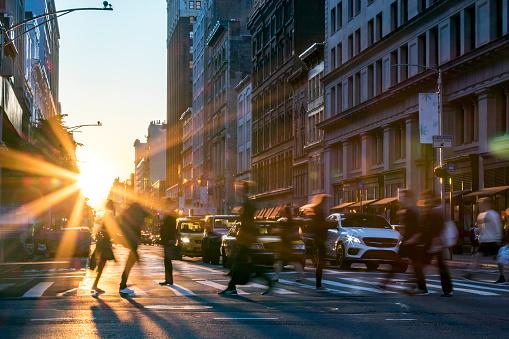 People crossing the street in Manhattan New York City 1057929832