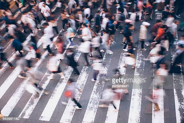 People crossing the street on walkway in Kyoto, Japan