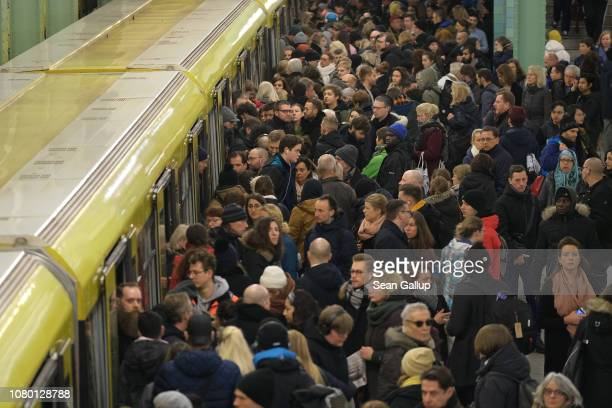 People crowd a platform while boarding an UBahn metro at Alexanderplatz during a strike by Deutsche Bahn workers on December 10 2018 in Berlin...