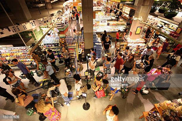 People crowd a Whole Foods store in Manhattan before the arrival of Hurricane Irene on August 26 2011 in New York City New York City Mayor Michael...