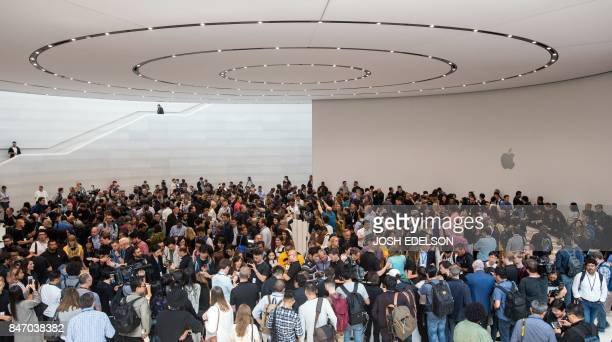 People crowd around new Apple products at Apple headquarters in Cupertino California on September 12 2017