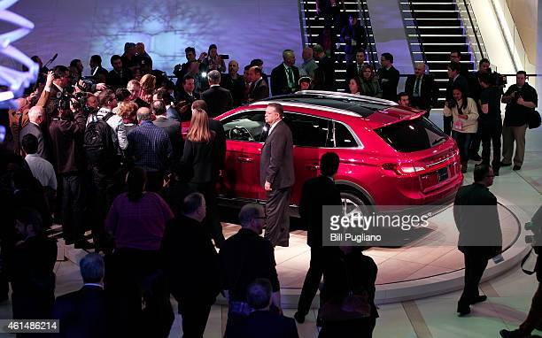 People crowd around the new Lincoln MKX Crossover vehicle as it makes its world debut at the 2015 North American International Auto Show on January...