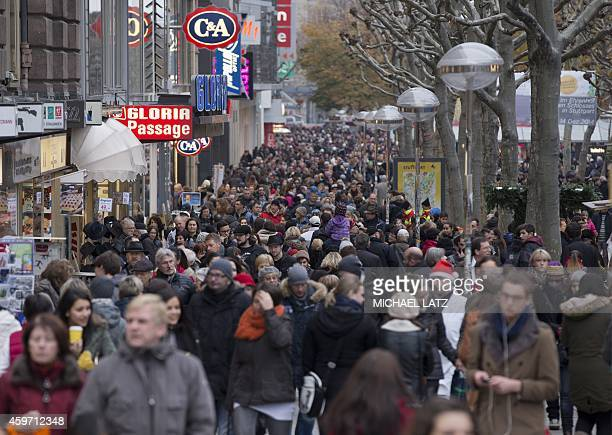 People crowd at Koenigsstrasse the main shopping street in Stuttgart southern Germany on November 29 2014 Many people started their Christmas...