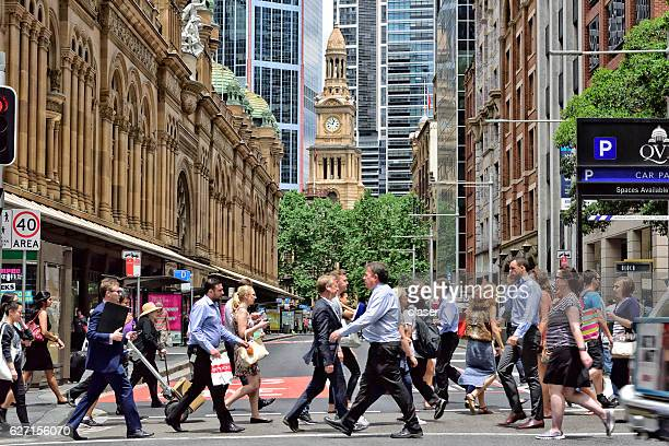 People crowd crossing street in central Sydney