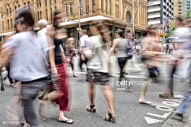 People crowd crossing street in central Sydney
