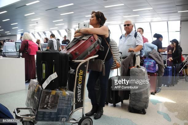 People crowd Fort Lauderdale International Airport as evacuation is underway for the arrival of Hurricane Irma September 7 2017 in Fort Lauderdale...