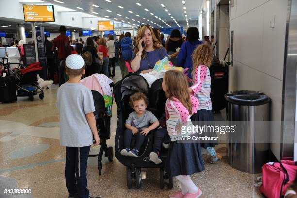 People crowd Fort Lauderdale International Airport as evacuation is underway for the arrival of Hurricane Irma September 7 2017 in Fort Lauderdale...