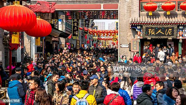 People crowd in a temple fair on the ancient culture street to celebrate Chinese lunar new year